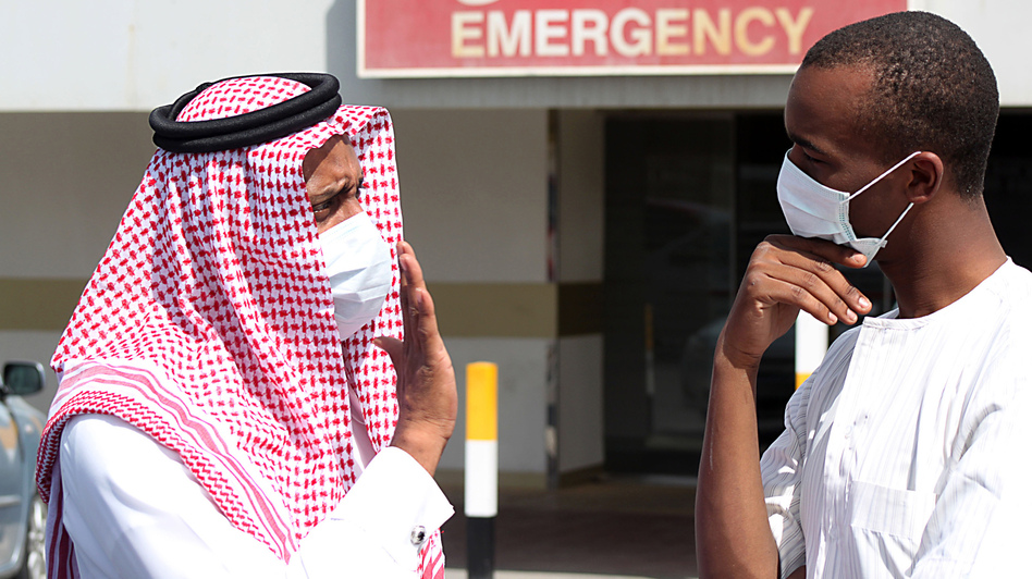 Men outside a hospital in Dammam, Saudi Arabia, wear surgical masks as a precaution against infection with a coronavirus. (Reuters /Landov)