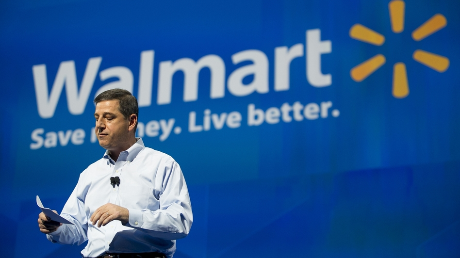 Wal-Mart U.S. CEO Bill Simon speaks to shareholders at Bud Walton Arena in Fayetteville, Ark., during this week's shareholders' meeting. The company is coping with a bribery scandal, as well as demands from workers.