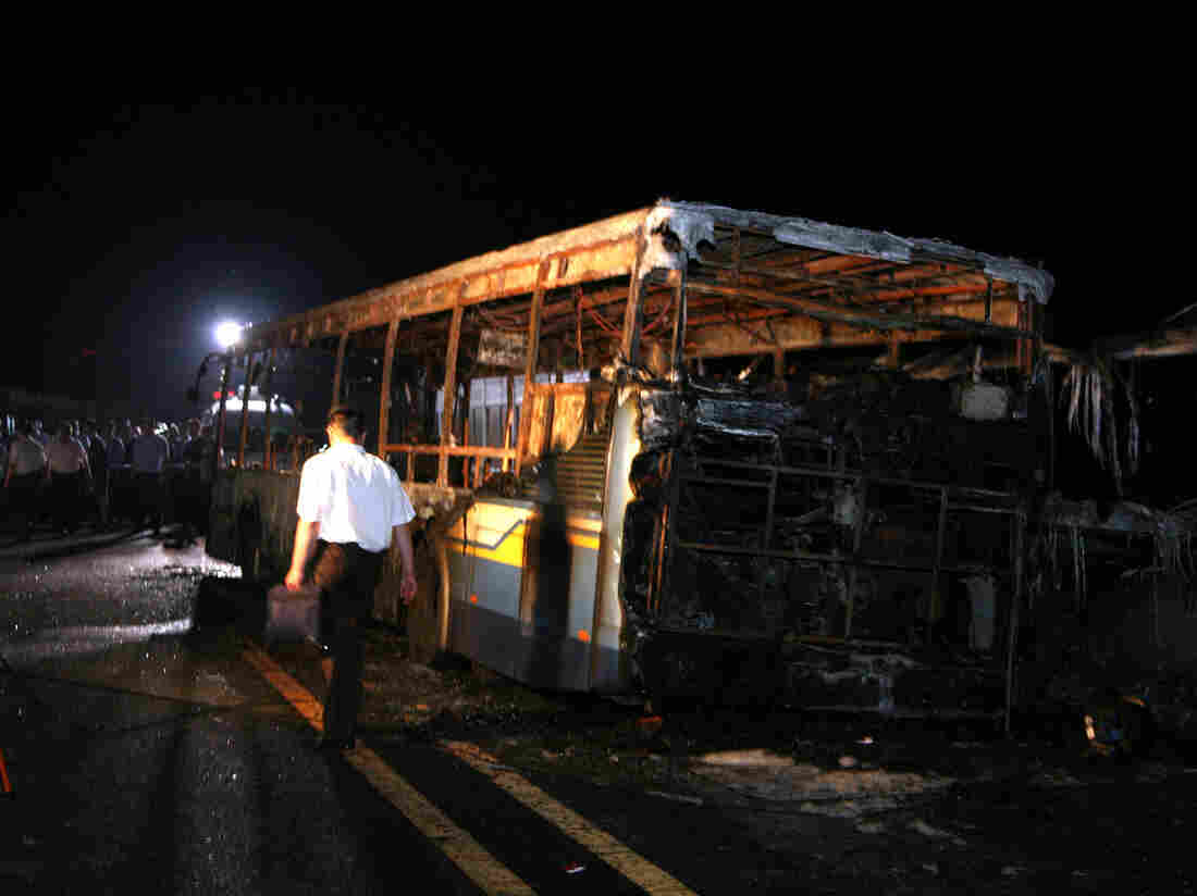 Photo taken Friday of the burned-out bus in Xiamen, China, where 47 people were killed in an apparent arson-suicide.
