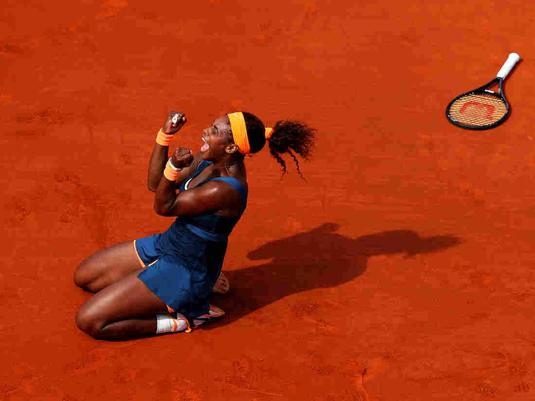 Serena Williams celebrates match point Saturday against Russian Maria Sharapova at Roland Garros in Paris.