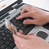 Hands on a keyboard.