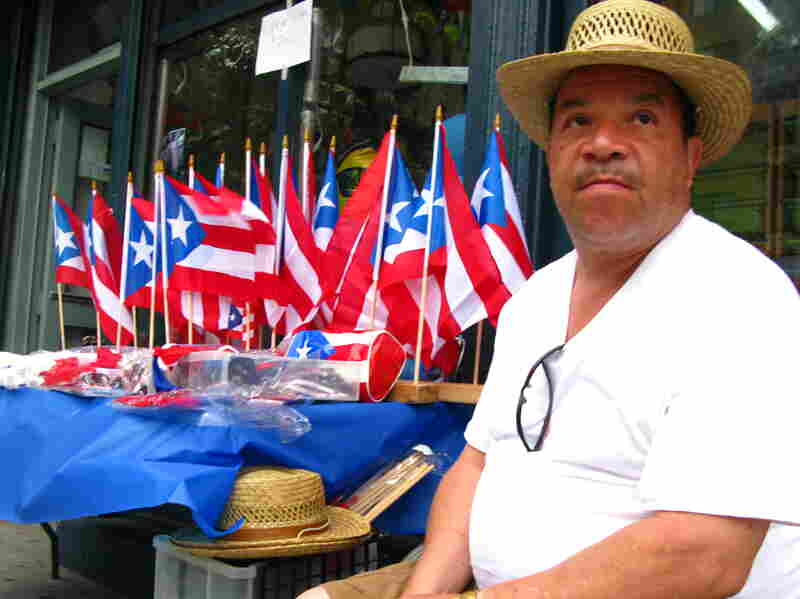 "Longtime East Harlem resident Johnny Montanez, 53, says he sells Puerto Rican flags and T-shirts a few doors down from his apartment building to show that Puerto Ricans are ""still here."""