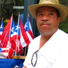 """Longtime East Harlem resident Johnny Montanez, 53, says he sells Puerto Rican flags and T-shirts a few doors down from his apartment building to show that Puerto Ricans are """"still here."""""""