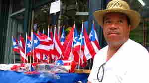 Puerto Rican Flags Wave To New York's Parade-Goers