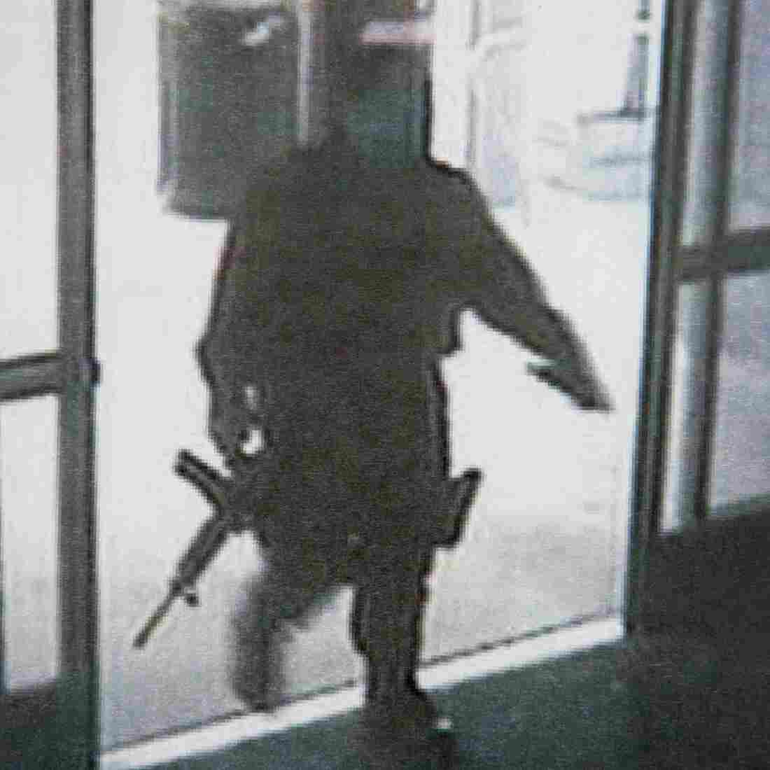 This photo provided by the Santa Monica Police Department during a news conference Saturday shows a frame grab from a surveillance camera revealing the suspect entering Santa Monica College on Friday.