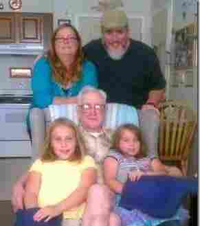 Michael and Katharine Powers don't expect to be able to retire. Here, they are with two of their daughters and Michael's grandfather.
