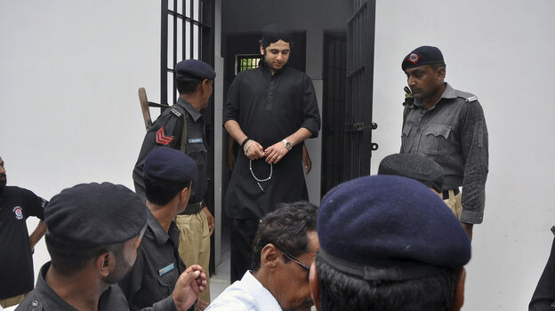 Shahrukh Jatoi, top center, convicted of killing 20-year-old Shahzeb Khan, is escorted by members of the police to an Anti-Terrorism court in Karachi, Pakistan, on Friday.