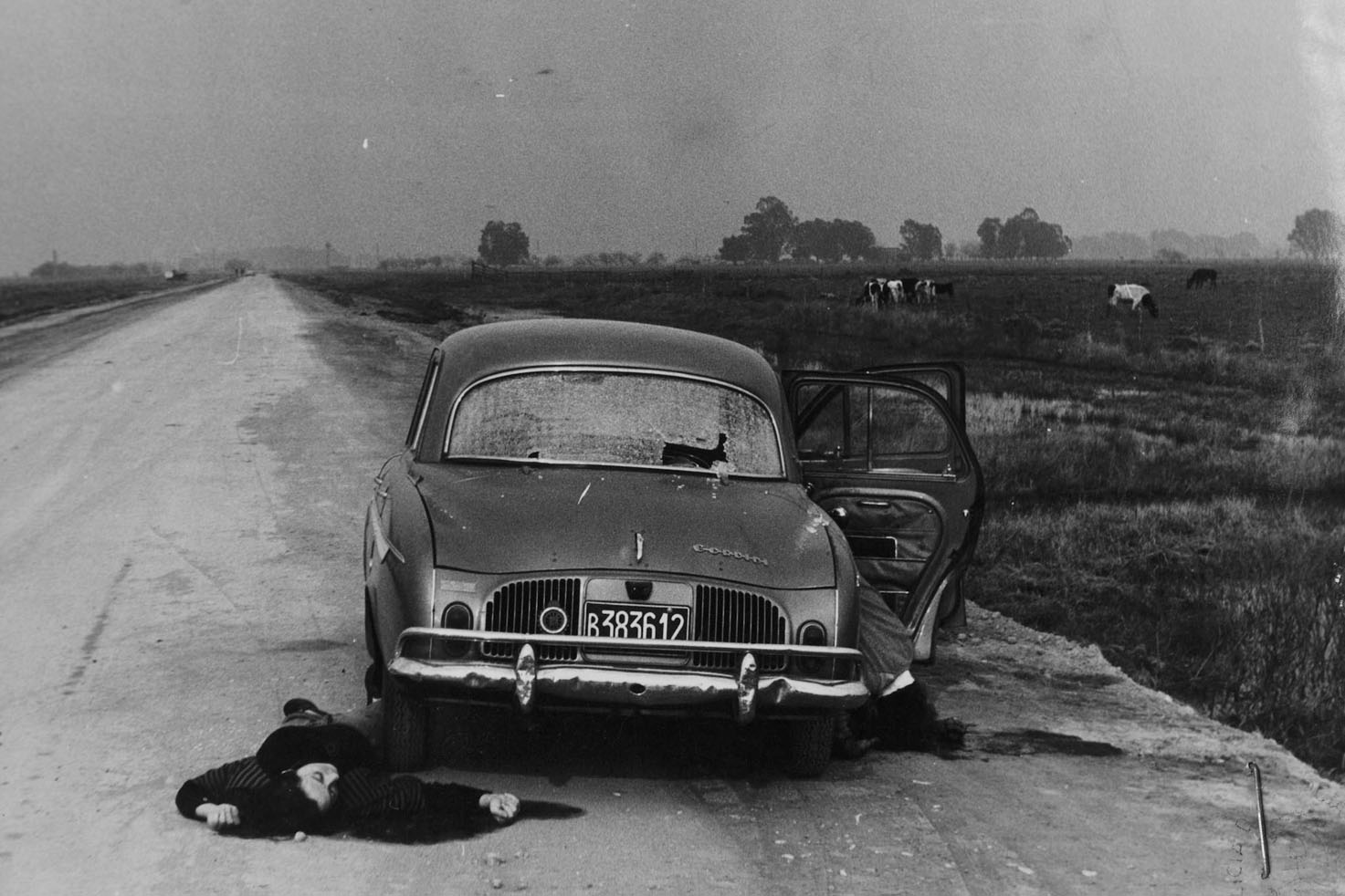 A woman lays dead on the side of the road after the car she was in was shot by right-wing paramilitary forces known as Triple A (Argentine Anti-communist Alliance) on the outskirts of La Plata, Argentina.