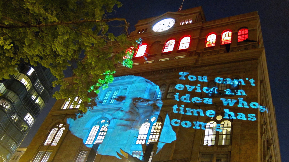 An image of Cooper Union founder Peter Cooper is projected on the office of school President Jamshed Bharucha, in protest of the institution's decision to begin charging tuition.