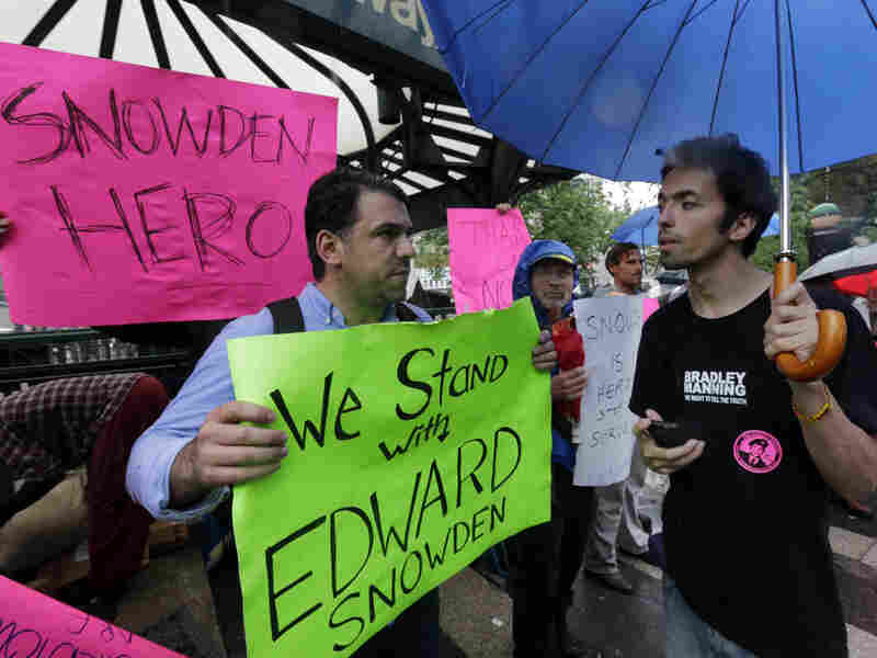 Demonstrators hold signs supporting Edward Snowden in New York's Union Square Park, on Monday. Snowden, who says he worked as a contractor at the National Security Agency and the CIA, gave classified documents to reporters, making public two sweeping U.S. surveillance programs and touching off a national debate on privacy versus security.