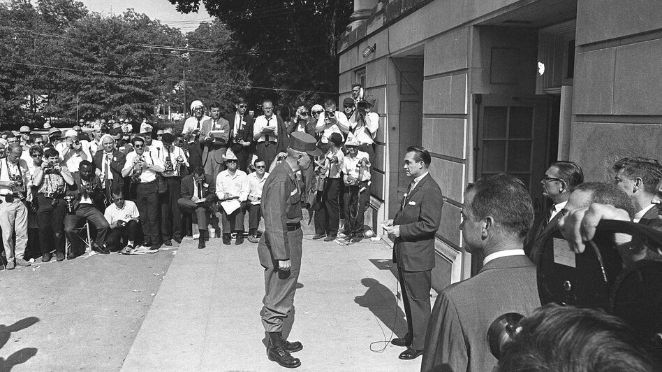 Alabama Gov. George Wallace (right) blocks the door of the the Foster Auditorium at the University of Alabama in Tuscaloosa, Ala., on June 11, 1963. Wallace, who had vowed to prevent integration of the campus, gave way to federal troops. (AP)