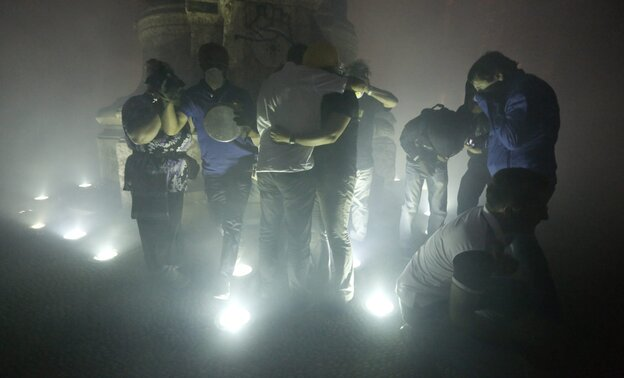 People run away from tear gas which is thrown by riot police during a clash at Taksim Square in Istanbul, Turkey.