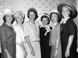 Annie Glenn, Rene Carpenter, Louise Shepard, Betty Grissom, Trudy Cooper and Marjorie Slayton attend a luncheon held in their honor by the American Newspaper Women's Club on April 27, 1962, in Washington, D.C. Mercury Seven wife Josephine Schirra is not pictured.