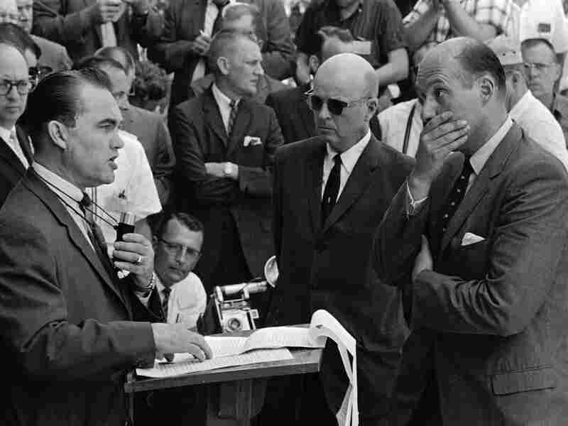Gov. Wallace promises to block black students from enrolling at the University of Alabama while Nicholas Katzenbach, deputy attorney general of the United States listens.