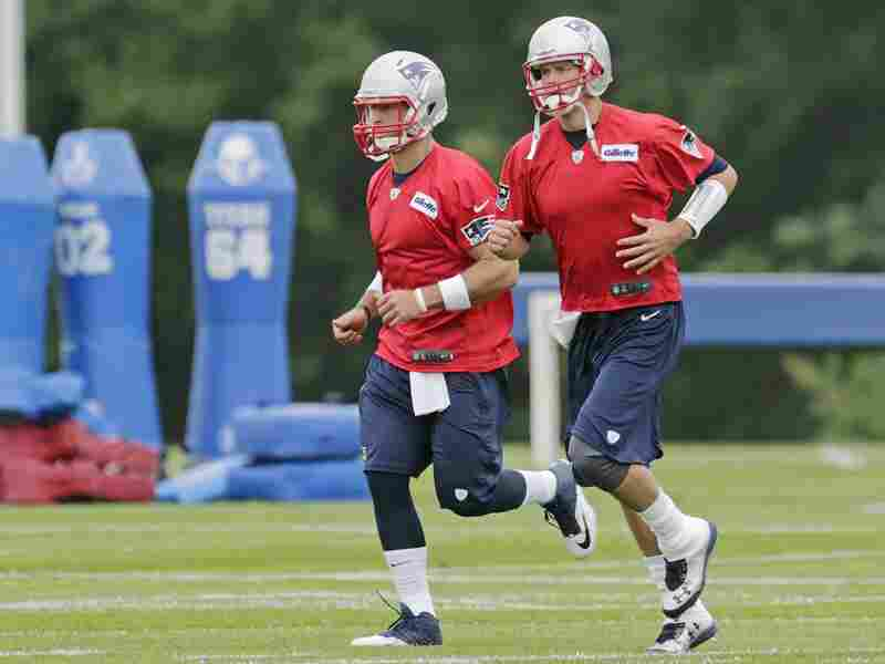 Tebow (left) runs with Patriots quarterback Tom Brady during practice. Tebow may not start games next season, but he will get something more valuable by being on the team.
