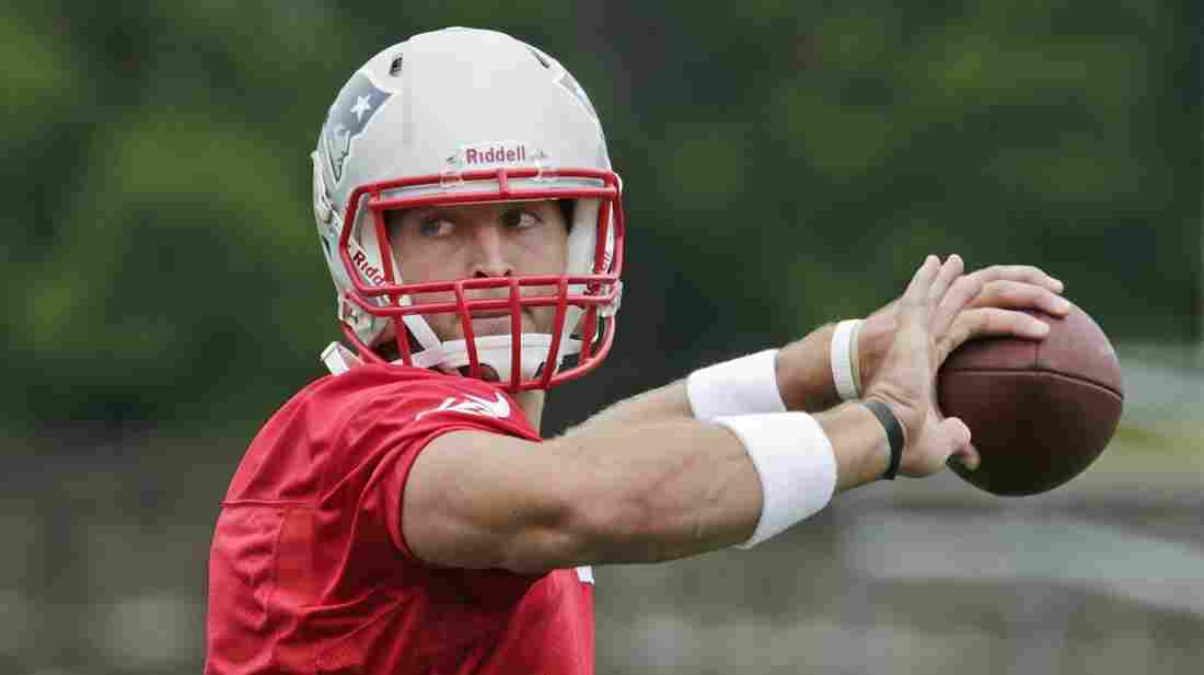 New England Patriots quarterback Tim Tebow throws during practice in Foxborough, Mass., on Tuesday.
