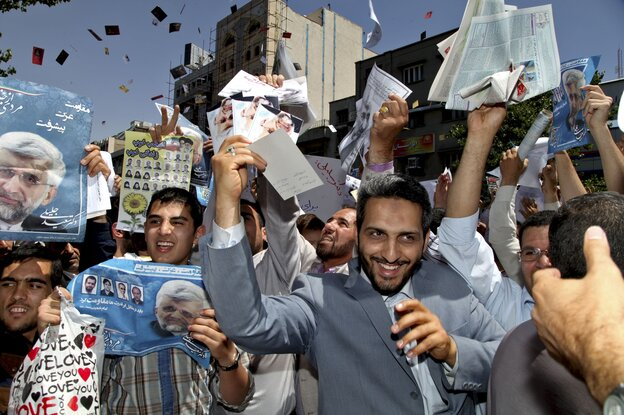 Supporters of Saeed Jalili, Iran's top nuclear negotiator and a candidate in Iran's June 14 presidential election, attend a street campaign after Friday prayers in Tehran on June 7.