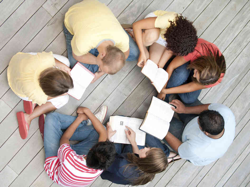 A group of young adults reading