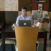 Nay Aung, founder of a tech startup in Yangon, Myanmar, sits in Taste Cafe, which served as his unofficial office for his first few months in the country. (It was one of the few places in town with a stable Internet connection.)
