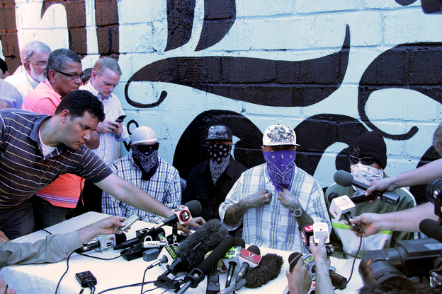 Members of the 18th Street gang announce a truce during a press conference at a prison in San Pedro Sula, on May 28. The gang is involved in drug trafficking that has brought terror to El Salvador, Guatemala and Honduras. (AFP/Getty Images)