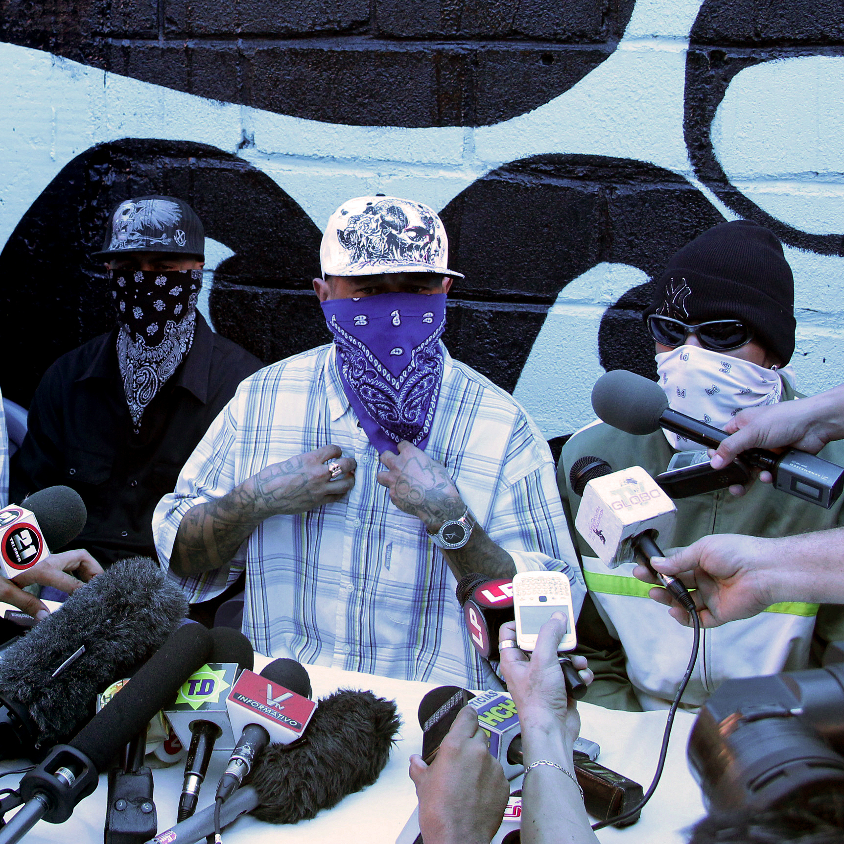 Members of the 18th Street gang announce a truce during a press conference at a prison in San Pedro Sula on May 28.