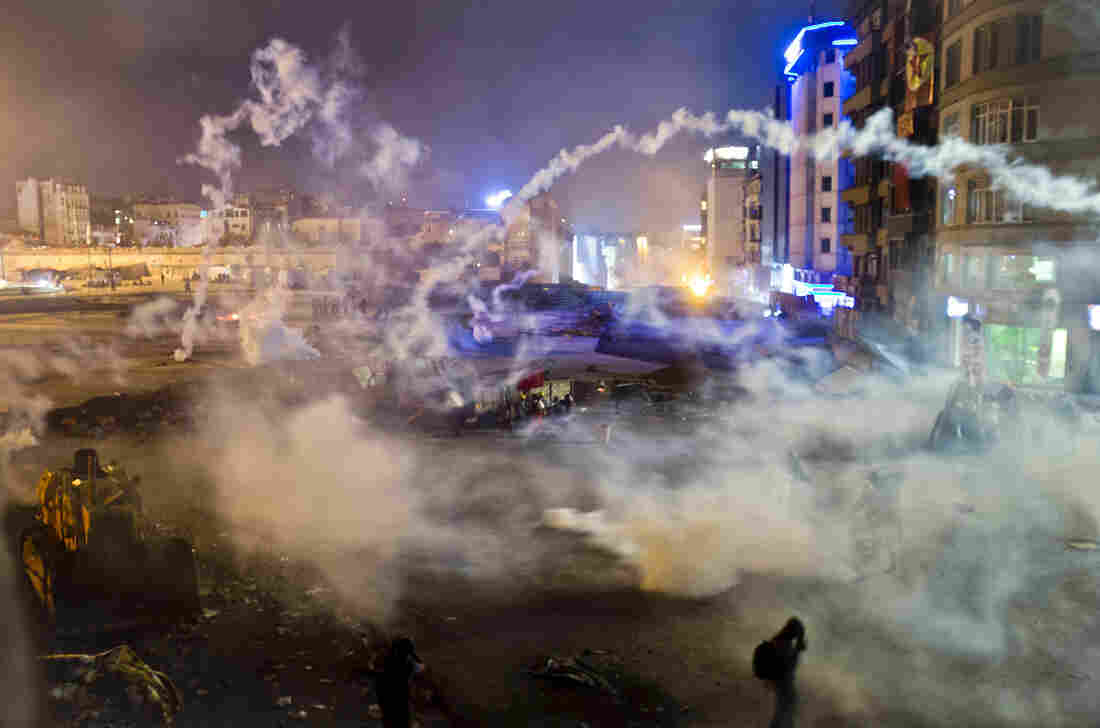 Taksim Square is flooded by tear gas as clashes between protesters and riot police continue into the night in Ista