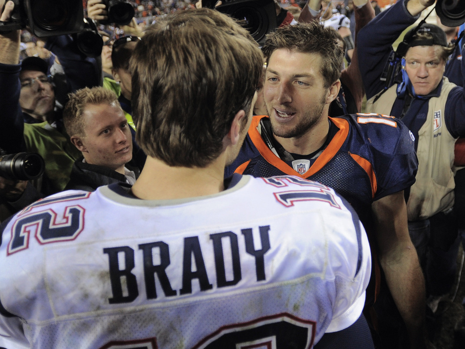 Tim Tebow (right) shakes hands with New England Patriots quarterback Tom Brady after the Patriots defeated the Broncos on Dec. 18, 2011. Now, they're due to be teammates. (Mark Leffingwell /Reuters /Landov)