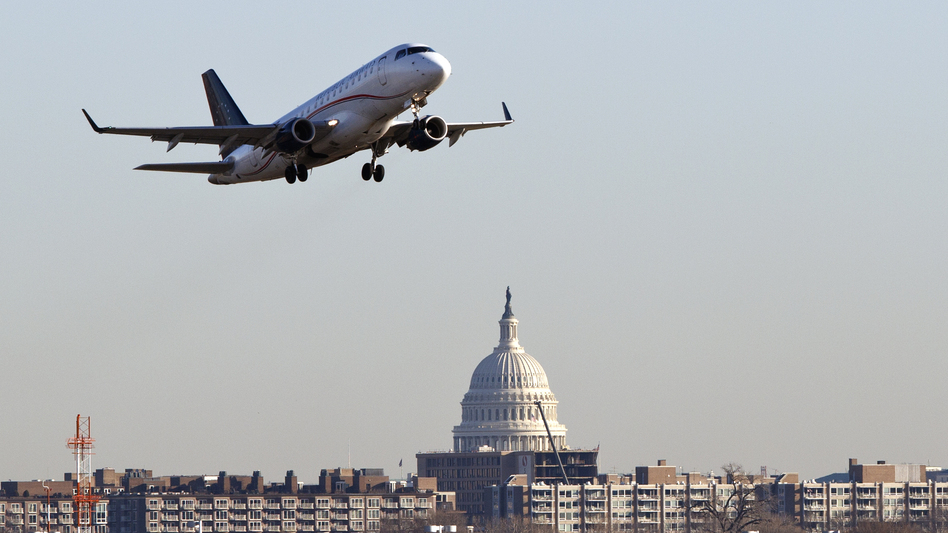 A jet takes off from Reagan National Airport, near the Capitol.