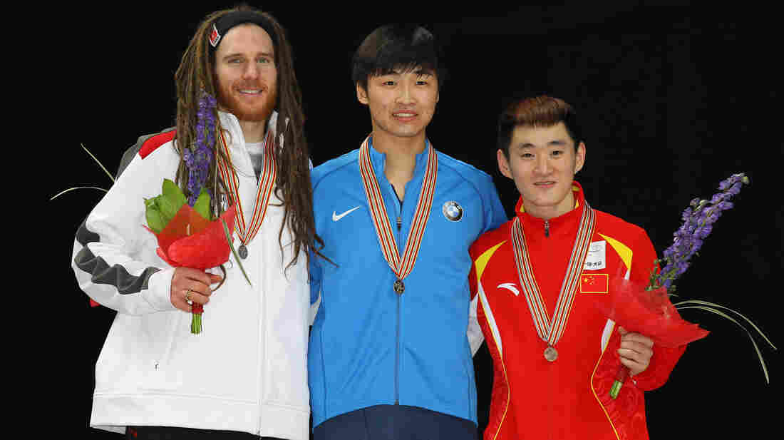 American short track speedskater Simon Cho (center) admitted last October that he sabotaged the skate blade of Canadian athlete Olivier Jean (left). The two are pictured here in 2011, at a different event.