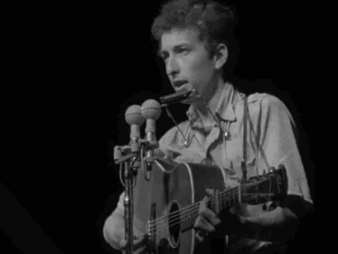 """Bob Dylan performs at the Newport Folk Festival in 1963. His set included """"Only a Pawn in Their Game,"""" which he would also play at the 1963 March on Washington."""