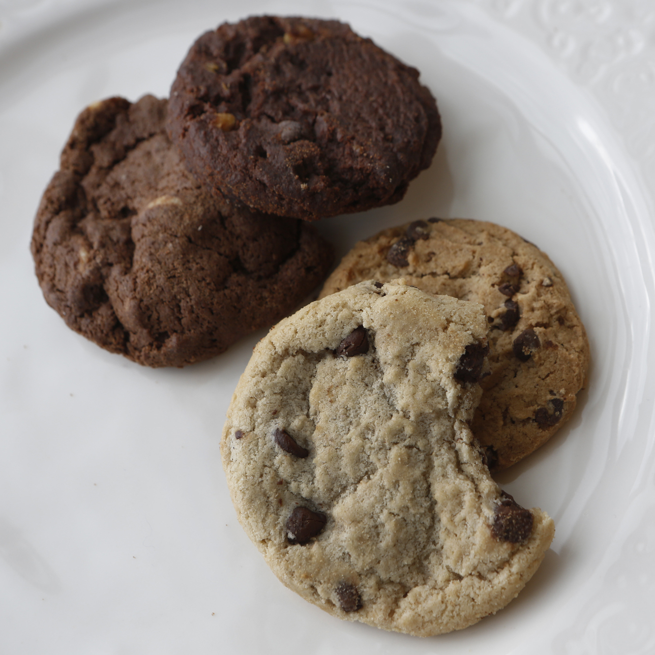 Can you tell the difference between these cookies? The chocolate chip and double chocolate chip cookies to the left are made without eggs while the two on the right are traditional cookies purchased from the grocery store.