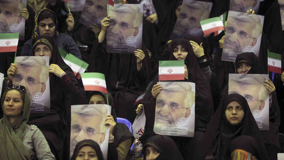 Female supporters of Iranian presidential candidate Saeed Jalili, Iran's top nuclear negotiator, hold up posters and national flags at a campaign rally in Tehran, Iran, on May 24. Jalili advocates for traditional roles for women and resistance against the U.S.