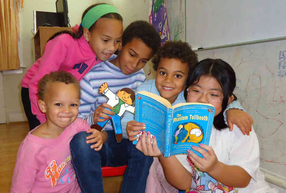Carina Jaffe, 3; Larissa Jaffe, 9; Denali Jaffe, 10; Zahra Jaffe, 6; and their friend Christina Tonnu, 8, read The Phantom Tollbooth together in Philadelphia.