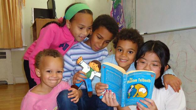 Carina Jaffe, 3; Larissa Jaffe, 9; Denali Jaffe, 10; Zahra Jaffe, 6; and their friend Christina Tonnu, 8, read The Phantom Tollbooth together in Philadelphia. (Courtesy the Jaffe Family)