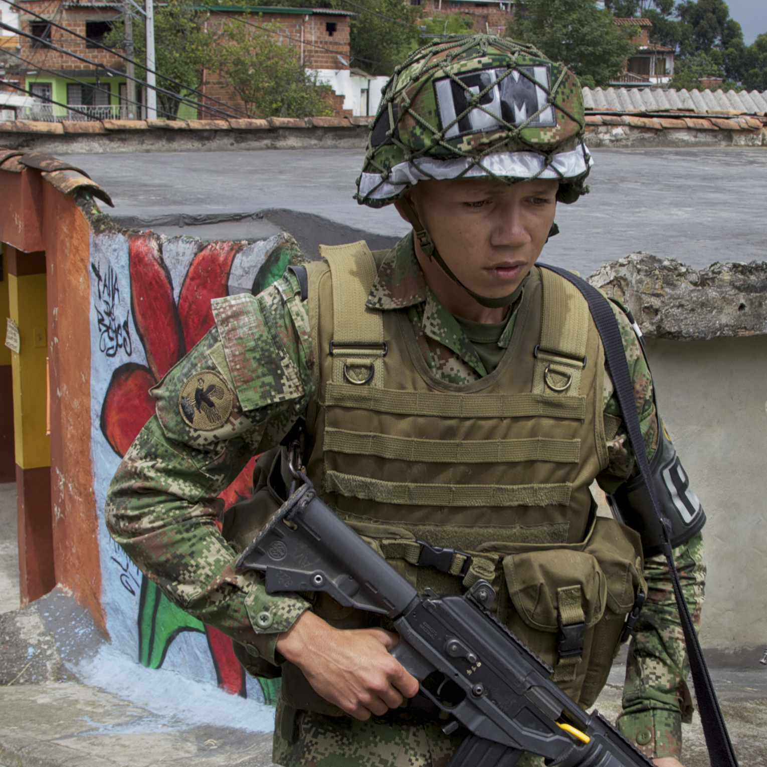 Colombian army soldiers patrol the Loma de Cristo�bal neighborhood after warring gangs forced dozens of families to flee. Medellin used to be the most dangerous city in the world but officials embarked on innovative projects designed to make life better in tough neighborhoods.
