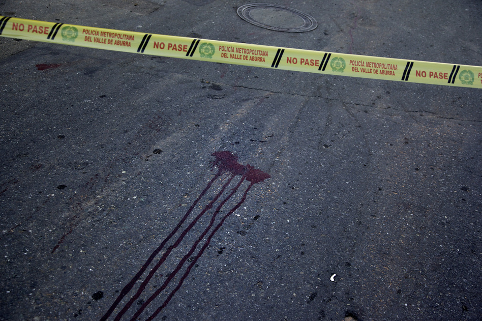 A double homicide in the neighborhood known as Beln in Medellin's southwest is marked by bloodstains. While the homicide rate has dropped by 80 percent, Medellin is not crime-free. (Paul Smith for NPR)