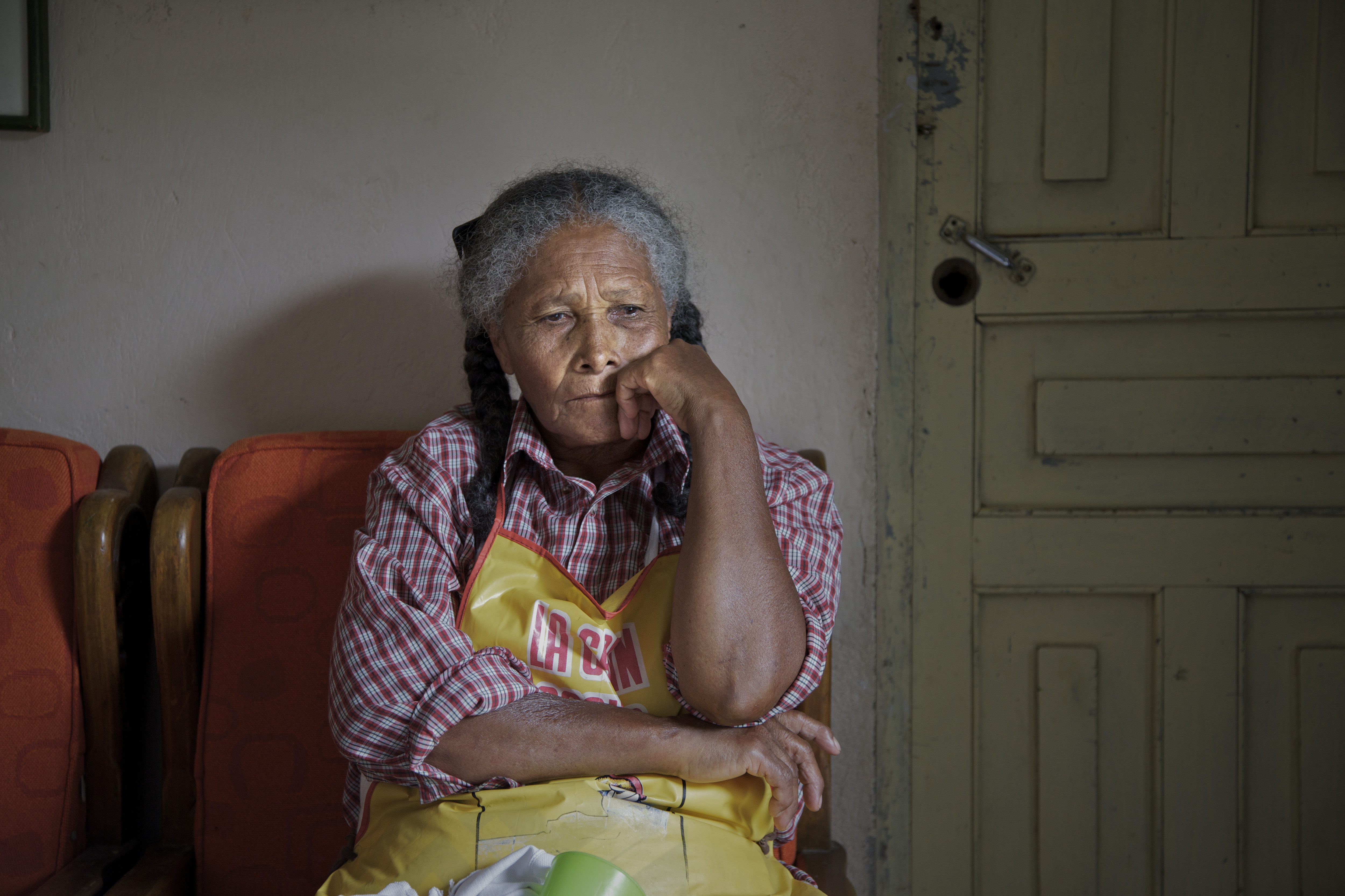Mara de Los Angeles Posada, 75, left her home in the Loma de Cristobal neighborhood because of warring gangs. On her return she wonders when the violence will flare again after the army leaves.
