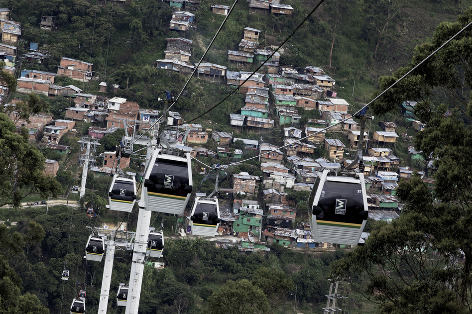 Gondolas that are perched high on steep mountains have been installed to connect Medellin's poorest neighborhoods. (Paul Smith for NPR)
