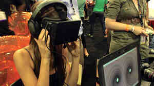 Actor Tamara Bruketta experiences the Oculus VR version of SoundSelf at the E3 gaming conference in Los Angeles.
