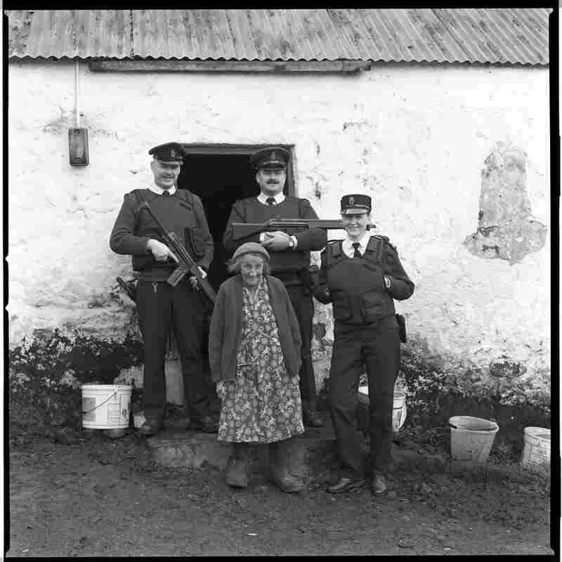Old woman with police and guns.