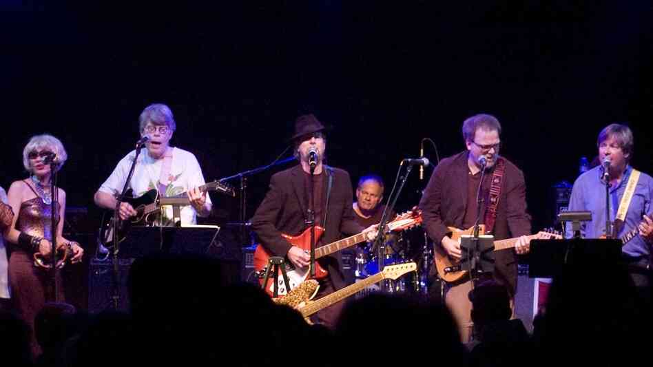 Given the number of books sold by members of The Rock Bottom Remainders, it's not necessarily a slur to say that their writing gifts far outshine their musicality. Here, drummer Josh Kelly and guitarist Roger McGuinn (at center) join authors Amy Tan, Stephen King, Greg Iles and Dave Barry.
