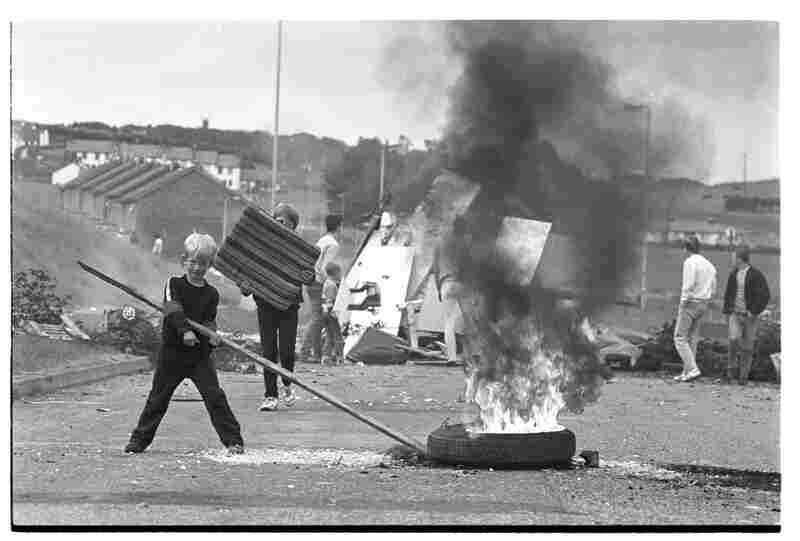 Children burn tires and block Flying Horse Road, Downpatrick, Northern Ireland, 1980s.