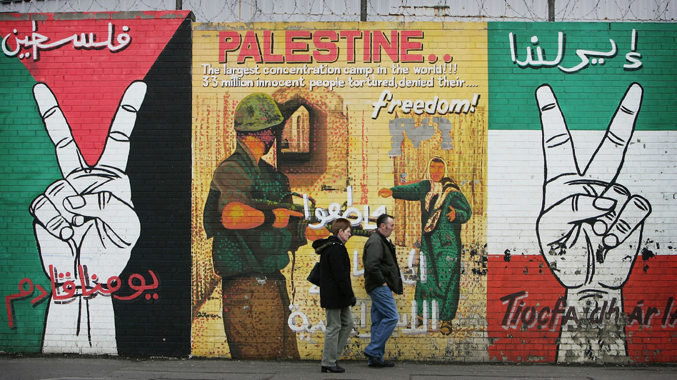 The peace wall on Belfast's Falls Road was traditionally used to display political messages from Irish Republicans. Today, artists use their skills to highlight political messages from around the world. (Getty Images)