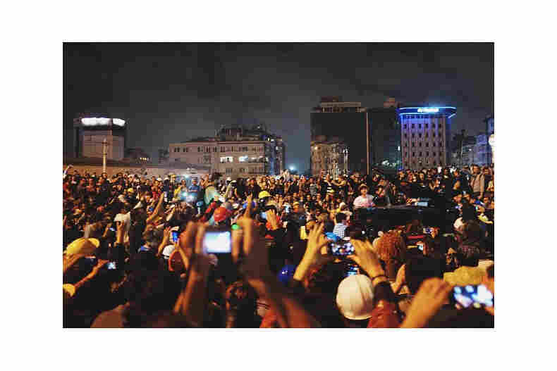 A crowd watches as a piano player performs in Taksim Square. (Posted June 12)
