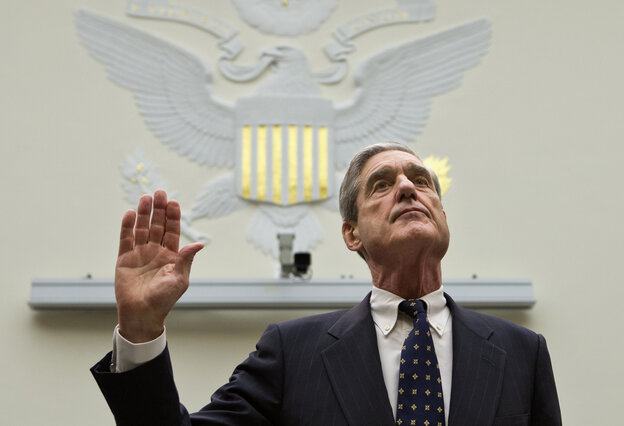 FBI Director Robert Mueller is sworn in on on Capitol Hill in Washington, on Thursday.