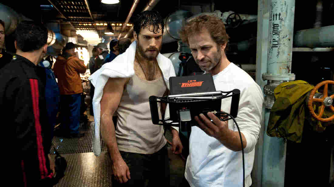 Actor Henry Cavill and director Zack Snyder confer on a shot for an early sequence in Man of Steel. Cavill is the first British actor to wear Superman's iconic red and blue — though not the first to play a D.C. comics superhero.