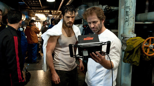 Actor Henry Cavill and director Zack Snyder confer on a shot for an early sequence in