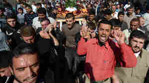 Mourners carry the body of a man killed last fall in the northern Syrian town of Azaz.