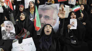 Female supporters of Iranian presidential candidate Saeed Jalili, Iran's top nuclear negotiator, chant slogans at a campaign rally in Tehran on Wednesday, two days ahead of the election.