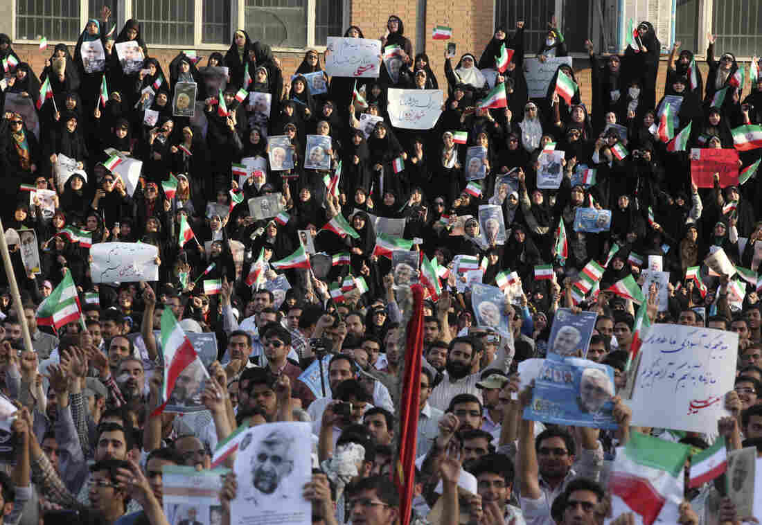 Iranians attend a campaign rally for Saeed Jalili, a leading presidential candidate, on Wednesday. Iranians vote on Friday, and the next president will have to deal with a weakening economy that faces increasingly tough international sanctions.